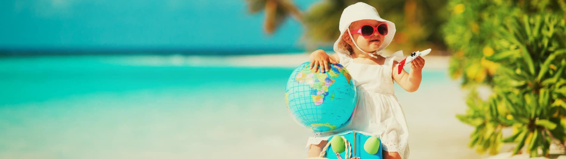 Bébé en vacances a la plage